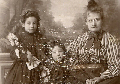 Mother With Daughters Holding Dolls. Oklahoma City,  Oklahoma Territory.