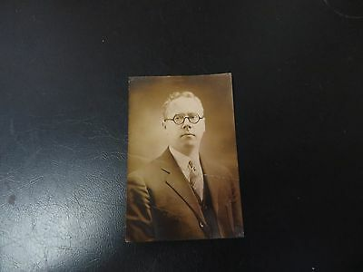 vintage sepia portrait of man w. circle glasses from the Max Huncke chemical co.