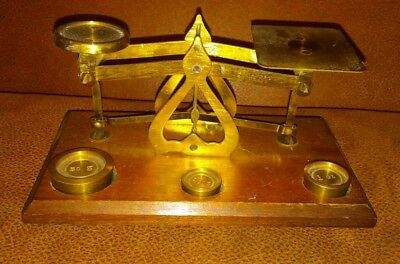 Antique brass and wood postal scale Made in England.  Nice condition