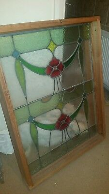Large wooden framed stained glass window