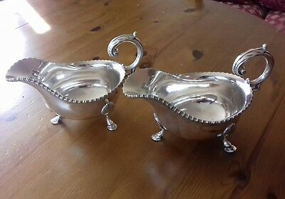 A pair of Goldsmiths & Silversmiths company regent plate gravy/sauce boats