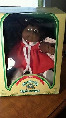 1984 Cabbage Patch kid brown hair brown eyes African Canadian.  Docs unopened