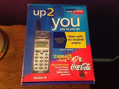 Ericsson coca cola mobile phone on 02 boxed comes with charger & in-car charger