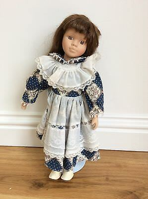 Pretty vintage doll with stand preowned
