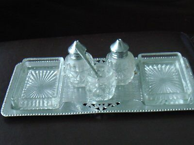 vintage cruet set on a tray with glass dishes