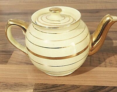 Vintage yellow and gold rimmed china tea pot