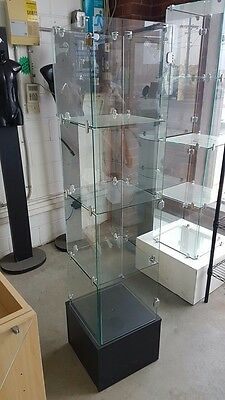 Frameless Glass Display Cabinet with Black Base and swinging door