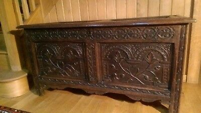 Antique 18th century oak coffer, well carved panels and scalloped front