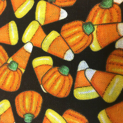 novelty halloween candy corn and pumpkins on black cotton fabric bty
