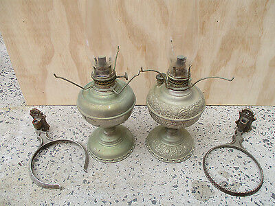 Two antique oil burner lamps. With wall hangers. Similar but not matching.