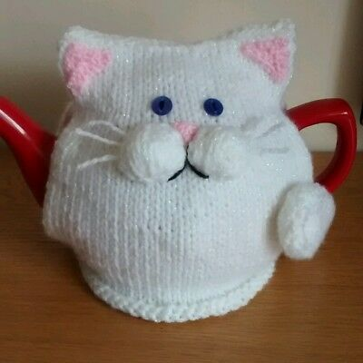 Hand-knitted white cat tea cosy. Fits medium/large pot.