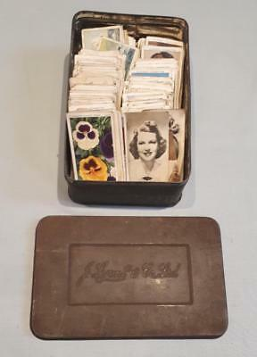 Nice vintage Lyons Tea tin with a collection of old cigarette cards. 1930s?