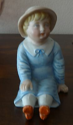 Bisque Figurine Small Boy Sitting Dressed In Blue Antique