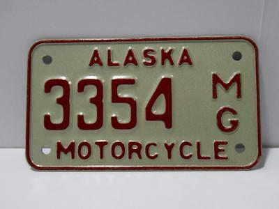Unissued 1976 Alaska Motorcycle license plate with envelope