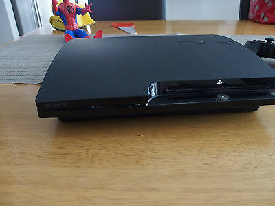 Sony PlayStation 3 Slim Charcoal Black 120 GB Console plus games