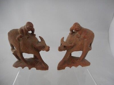 Pair of Chinese Carved Wooden Children Climbing on Buffalo's Backs Figures