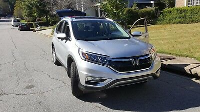 2015 Honda CR-V EX-L Sport Utility 4-Door Pristine , always garaged with low miles! Silver with black leather.