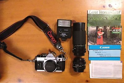 Vintage Canon AE-1 Program SLR Camera with 2 Canon Lenses and Flash Bulb