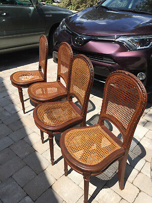 French Country Hand Woven Antique Cane Chairs with Motif Carving on Top of Chair