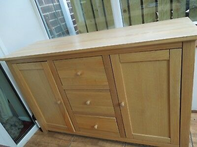 Sideboard light oak. two doors and three drawers.