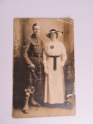 WW1 military postcard - Soldier of the Seaforth Highlanders with female.