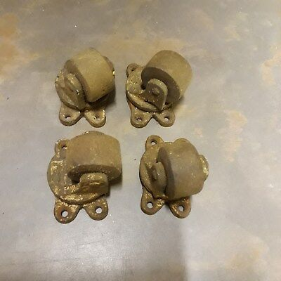 Rare vintage old set of 4 cast iron castors with wooden wheels