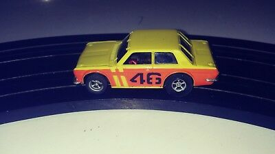 AFX Yellow Datsun 510 HO Scale slot car with new tires