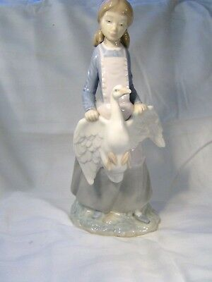 LLADRO/NAO A Pretty Young Girl carrying a Goose/Duck