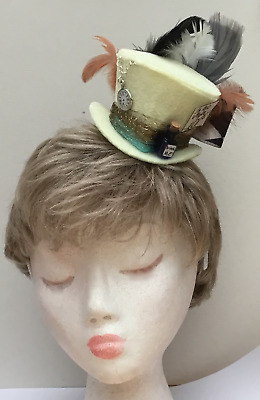 """Mad Hatter mini hat fascinator in cream with Pocket watch and """"drink me"""" Bottle"""