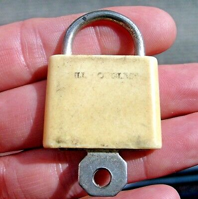 Vintage Flat bakelite or celluloid lock with push-key