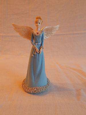 angel figurine:  5 inches, blue dress with red stone necklace