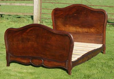 AN LATE 19th CENTURY FRENCH MAHOGANY VENEER DOUBLE BED WITH BASE
