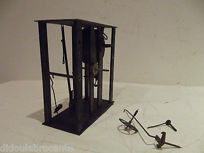 antique pendulum clock mechanism tiny comtoise clock spring? winder 19th century
