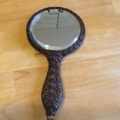Old leatherwork hand mirror with a tiger on,  maybe by georg hulbe