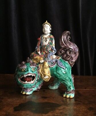 Japanese porcelain figure of Kannon (Guanyin) on a shishi (Foo dog), in famille