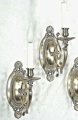 A Pair Of Mid Century Classical Regency Adams Shell Back Brass Sconces