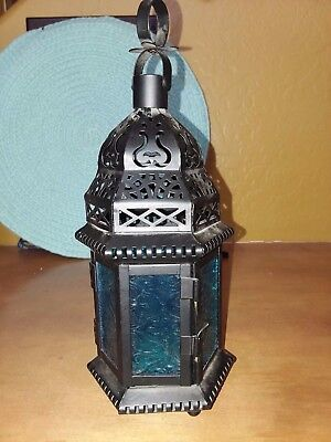 Black metal tabletop/hanging candle lantern with blue glass and door