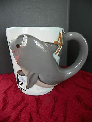 Dolphin coffee mug, dolphin in reliefDolphin coffee mug, dolphin in relief