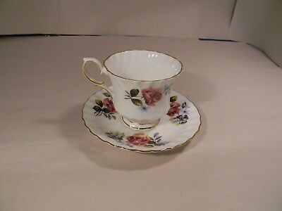 """Queen Anne Bone China England """"Roses"""" Teacup and Saucer"""