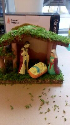 Small nativity set. Christmas ornament. Wooden stable with figures.