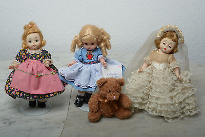 Madame Alexander 8 in Dolls..Lot of 7 No boxes have stands.Need stringing!