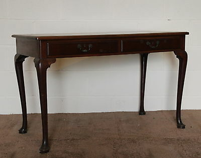 An Early Victorian Mahogany Two Drawer Side Table or Desk Cabriole Supports