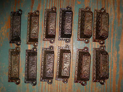 12 old CAST IRON PANTRY DRAWER PULLS BLUE BIRD AND TULIPS 1870s