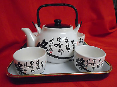 7 Piece Oriental Tea Set 4 Cups, Teapot With Lid & Handle  And  Matching Tray