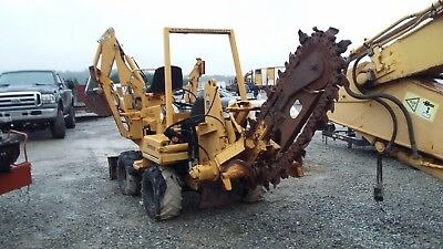 Vermeer V-3550A  Ride on Trencher with backhoe attachment , blade 1200 hours +/-