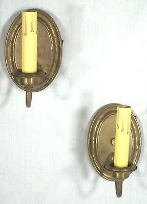 PAIR OF EARLY 20th CENTURY BRASS OVAL BACK SINGLE ARM SCONCES