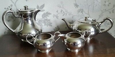 A Vintage 4 Piece Silver Plated Tea Service by Walker & Hall