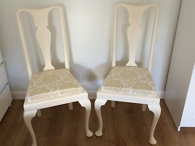 A pair of Queen Anne style dining chairs