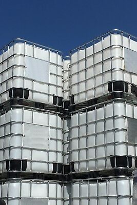 1000 litre IBC storage tanks in cages