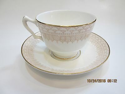 Crown Staffordshire Fine Bone China Cup and Saucer Est 1801 Gold Lace Design?